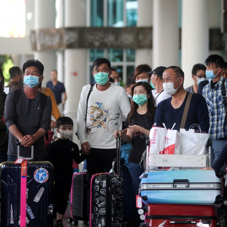 chinese tourists arriving in bali