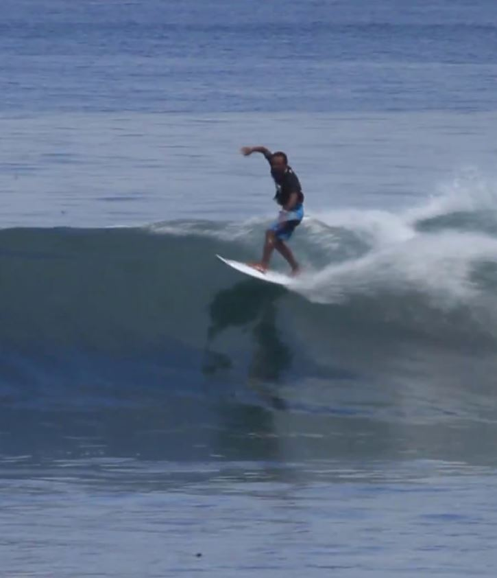 surfer riding wave in bali