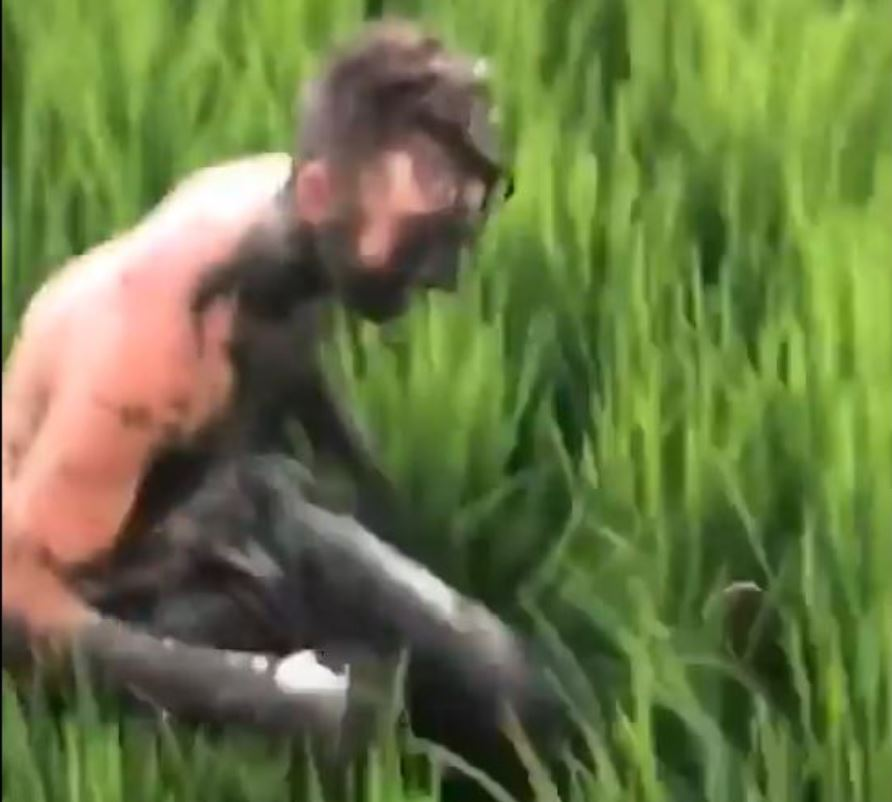 foreigner covered in dirt in bali
