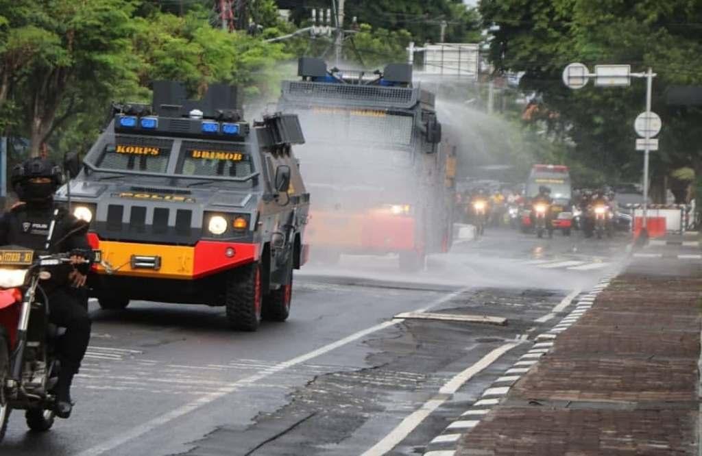 police sanitize streets in bali