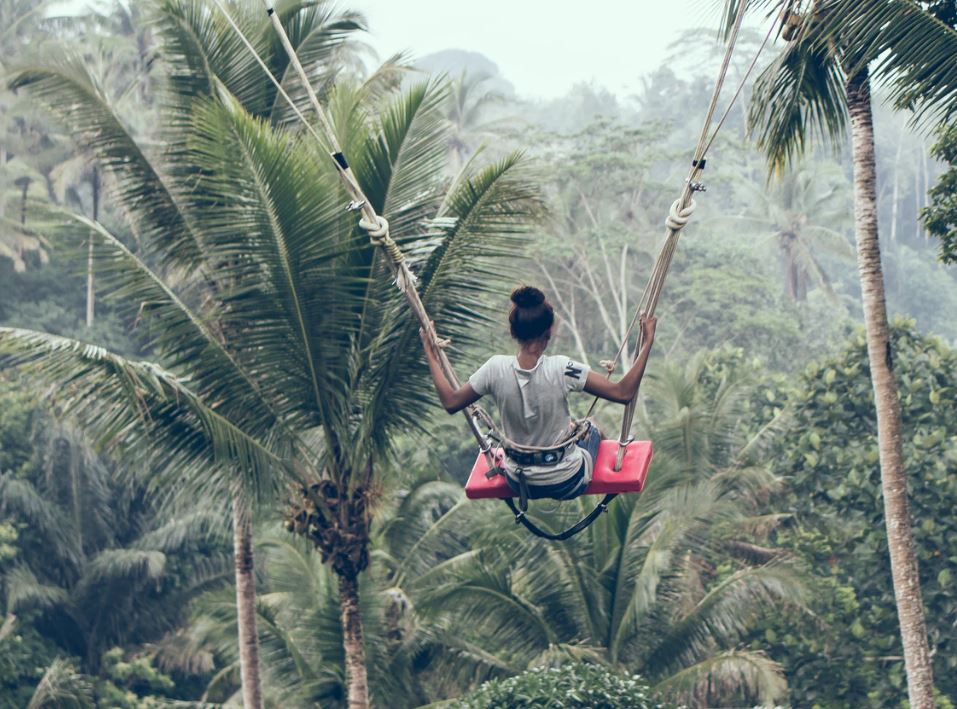 tourist on swing in bali