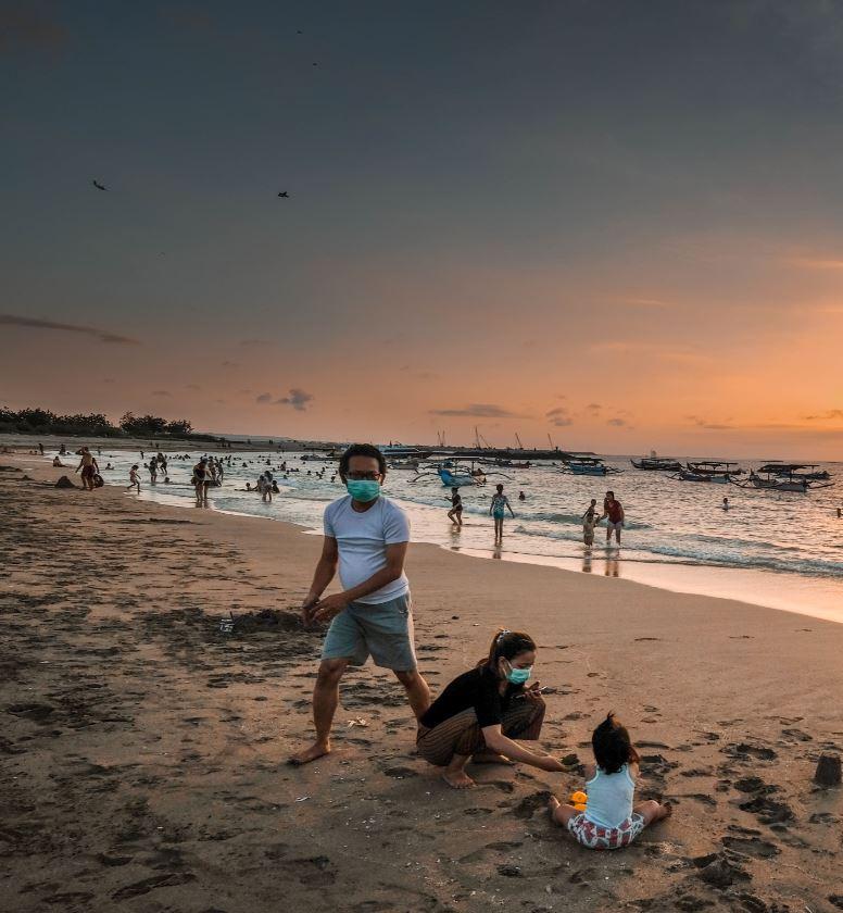 bali locals with masks at beach