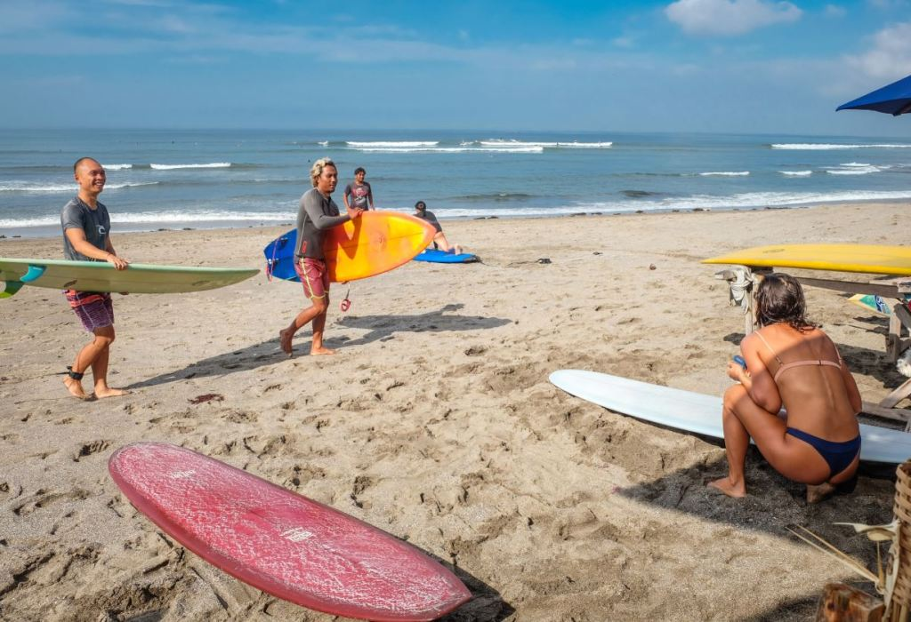 Bali tourists at beach surf
