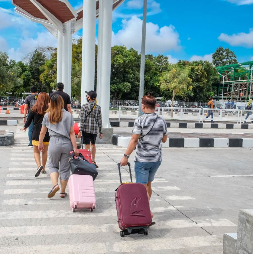 bali domestic tourists arrive in masks bali airport