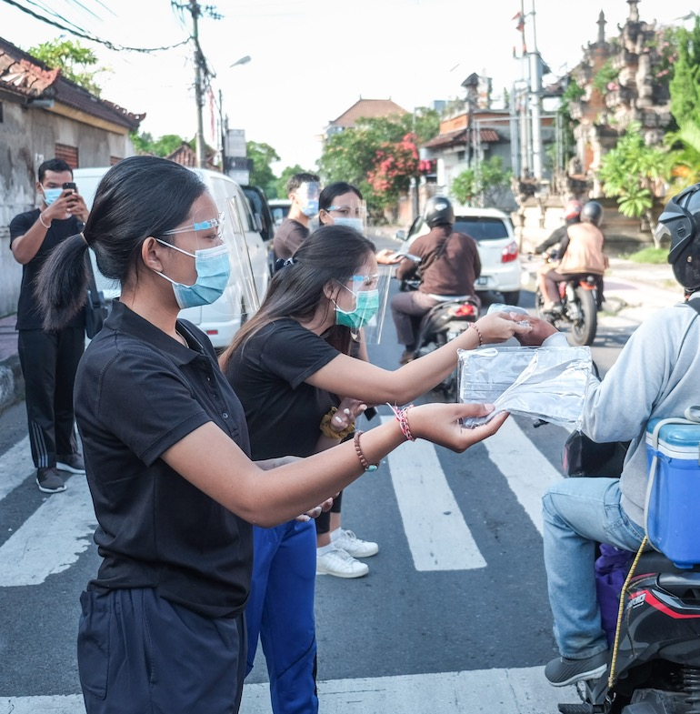 distributing masks in Bali