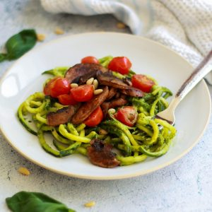 These paleo vegan pesto zoodles are the perfect alternative if you're following Whole30 or want a new way to eat veggie pasta! The pesto is easy, delicious, and will become a family favorite!