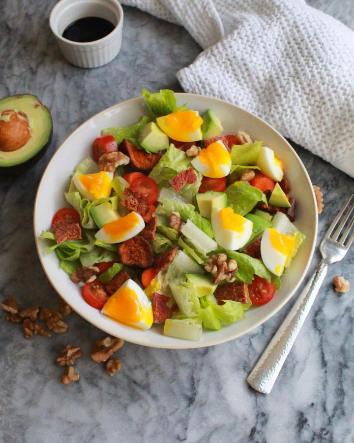 Paleo Cobb salad with avocado and balsamic vinegar on the side