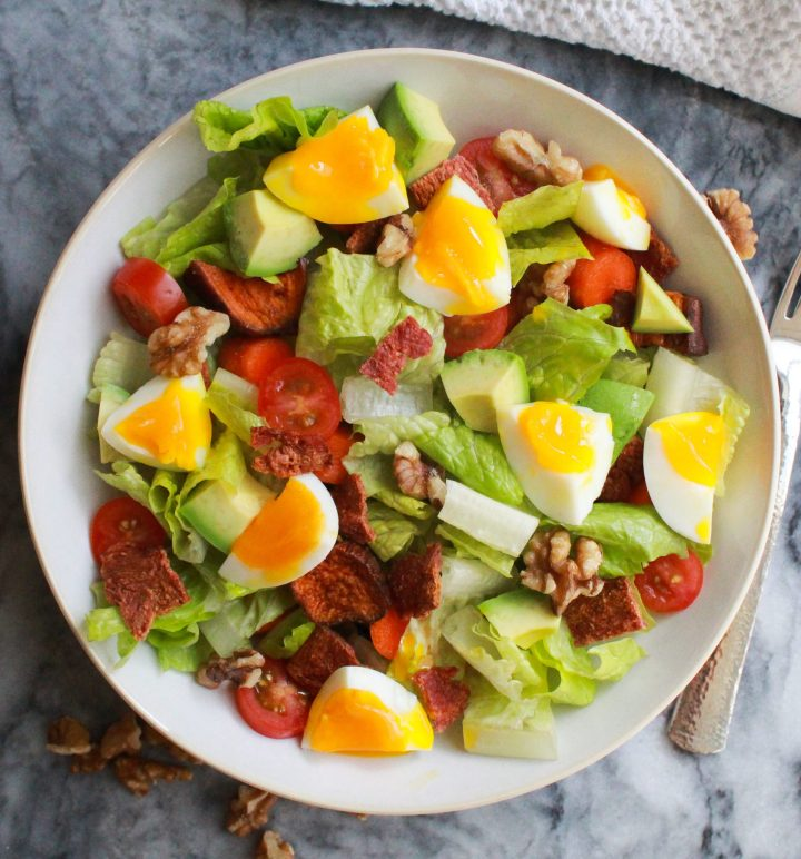 Paleo cobb salad undressed in a white bowl