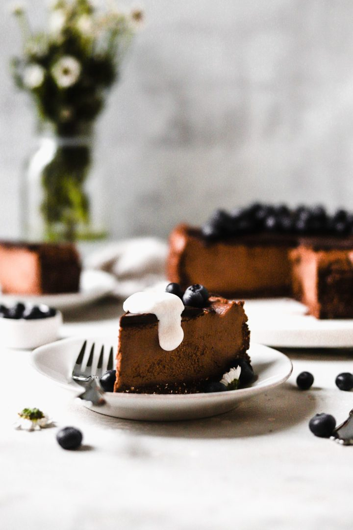 slice of chocolate cheesecake with whipped cream