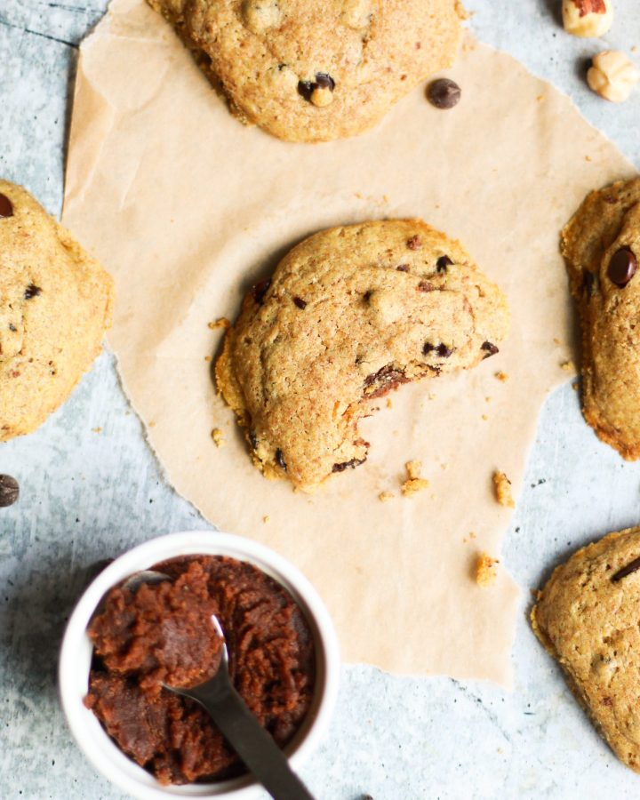 These gooey vegan Nutella stuffed chocolate chip cookies are downright addictive and completely dairy free, egg free, and refined sugar free! With chewy edges and a soft center, it's the perfect chocolatey bite!