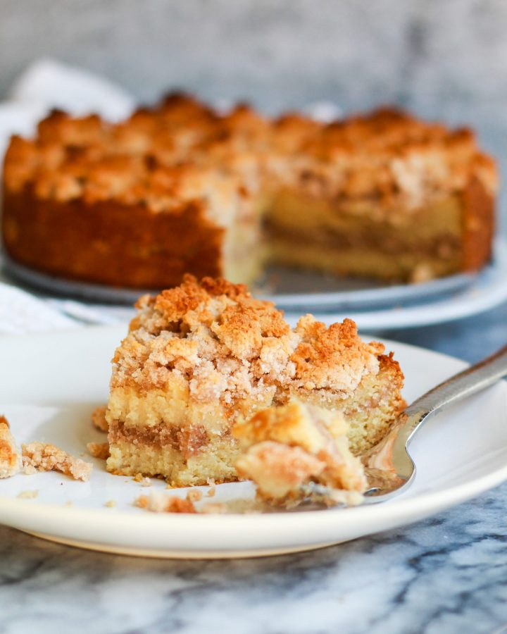slice of paleo cinnamon coffee cake with a bite out of it