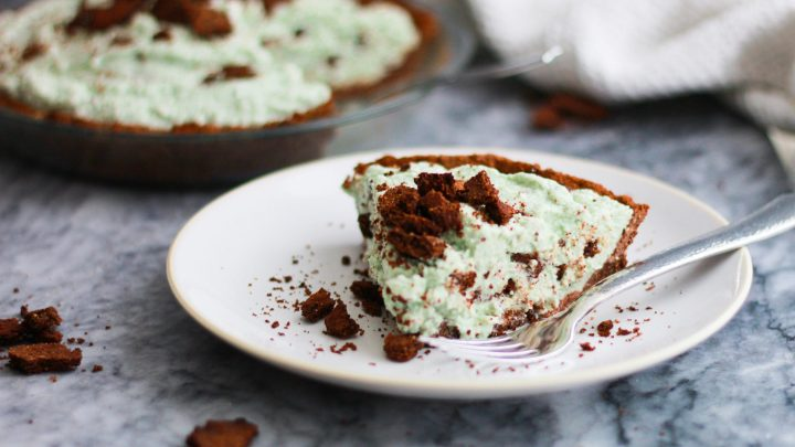 This vegan grasshopper pie made with a paleo vegan chocolate crust is absolutely decadent and minty fresh! It's completely paleo, gluten free, and made with natural coloring!
