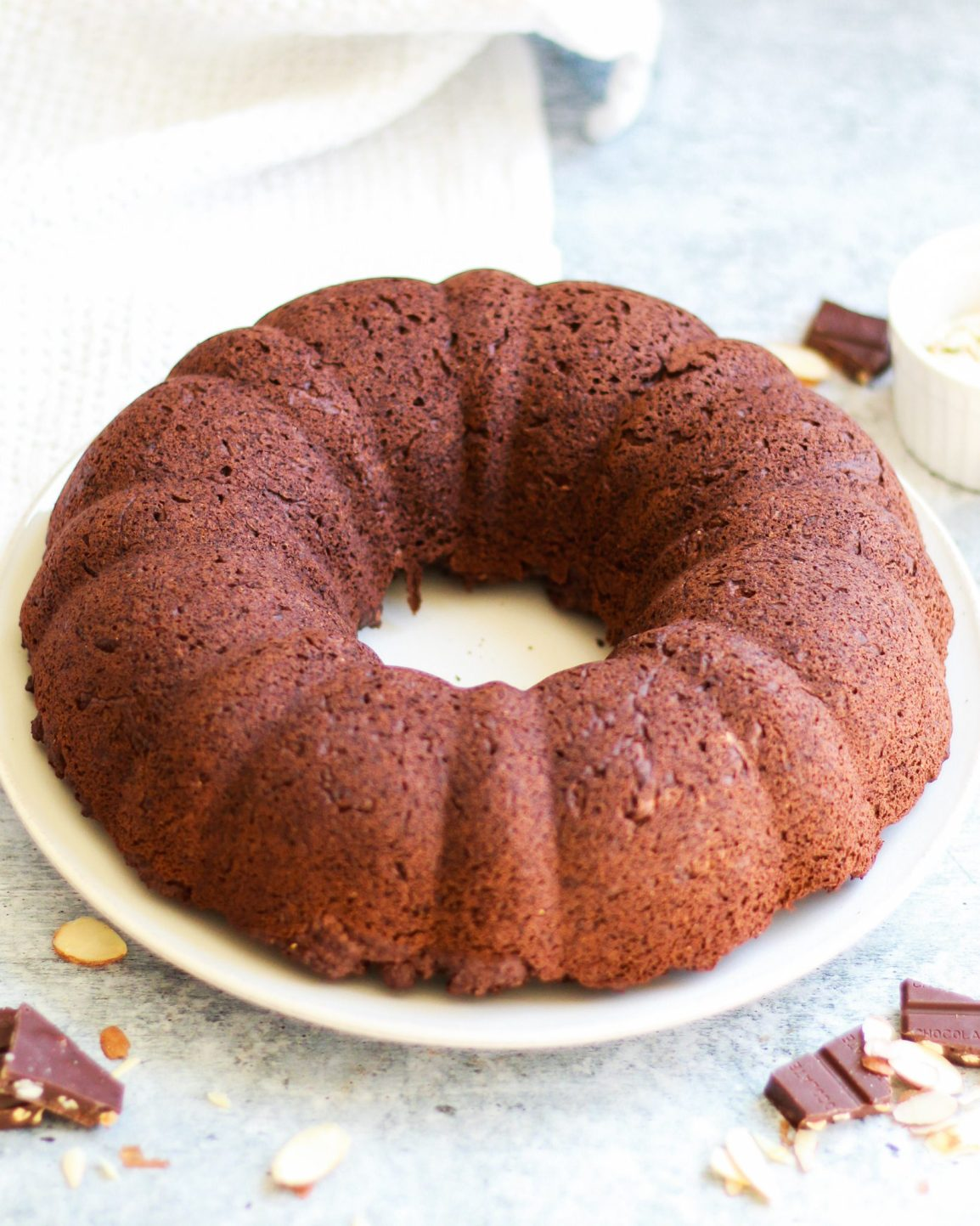 This healthy vegan chocolate bundt cake is a slice of chocolatey decadence on a plate! It's also completely gluten free and refined sugar free, and perfect for any age or occasion!