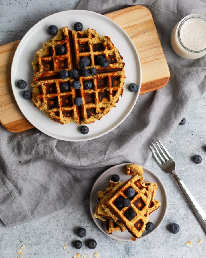 paleo sweet potato waffle with blueberries on a plate