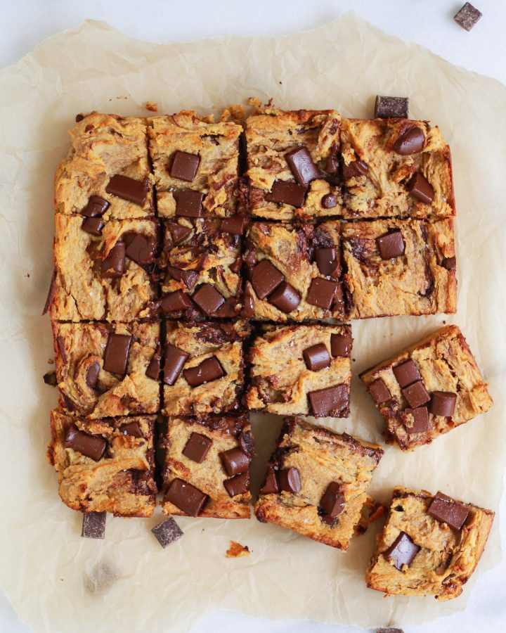 chocolate chip blondies on parchment paper