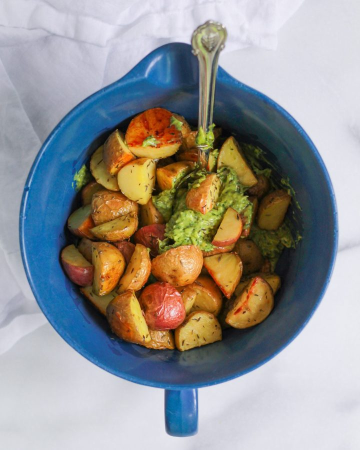 mixing bowl of potatoes and avocado pesto