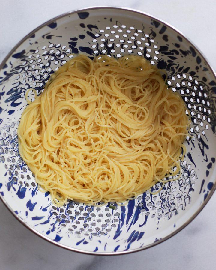 boiled pasta in colander