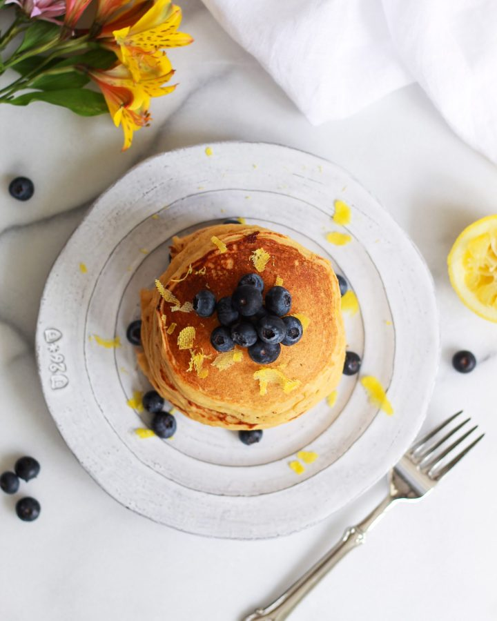 overhead shot of pancakes topped with blueberries