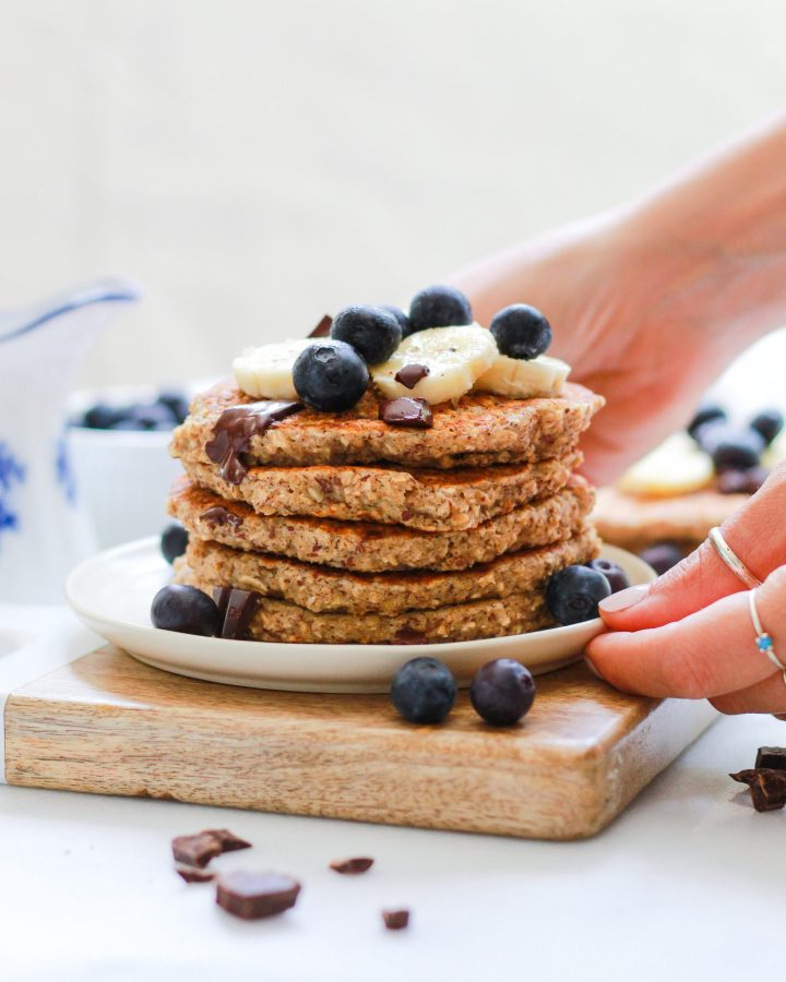 hands plating pancakes