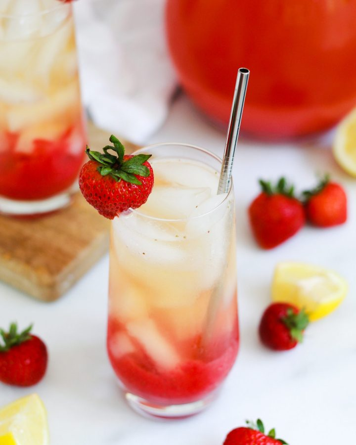 strawberry lemonade green iced tea with strawberry on rim