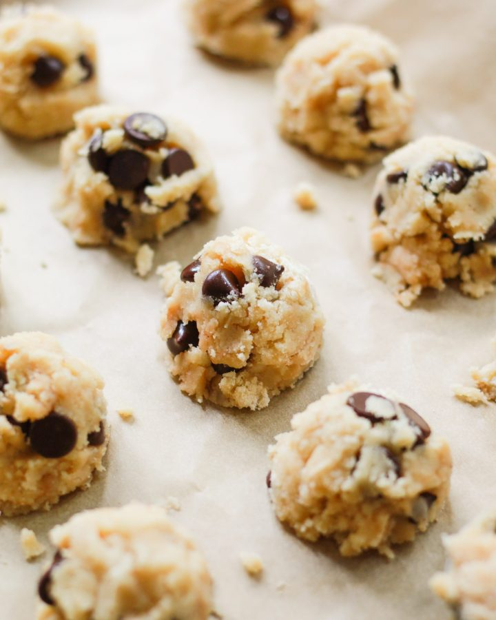 cookie dough truffles scooped onto parchment paper