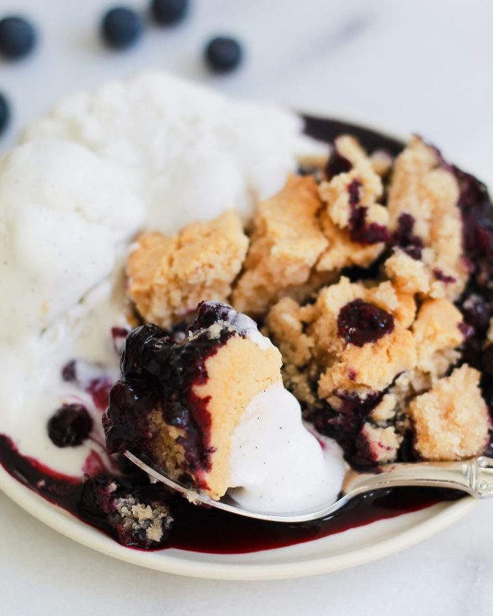 close up of spoon with vegan blueberry cobbler