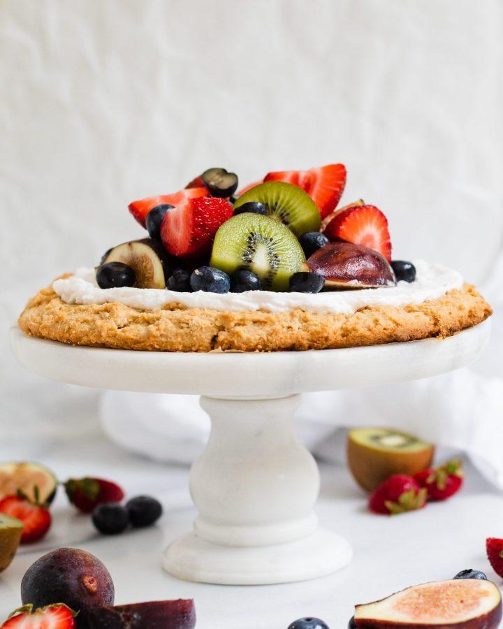 paleo fruit pizza on cake stand
