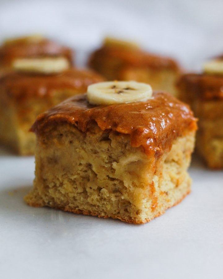 square of vegan banana cake with vegan peanut butter frosting