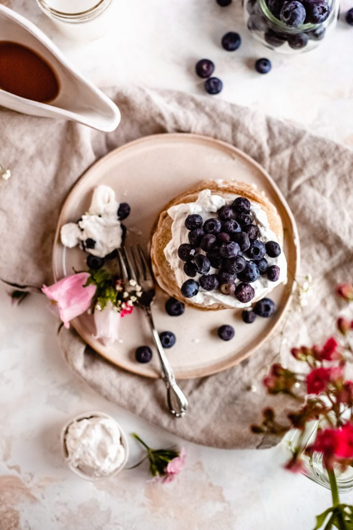 overhead of pancake stack on a plate with flower