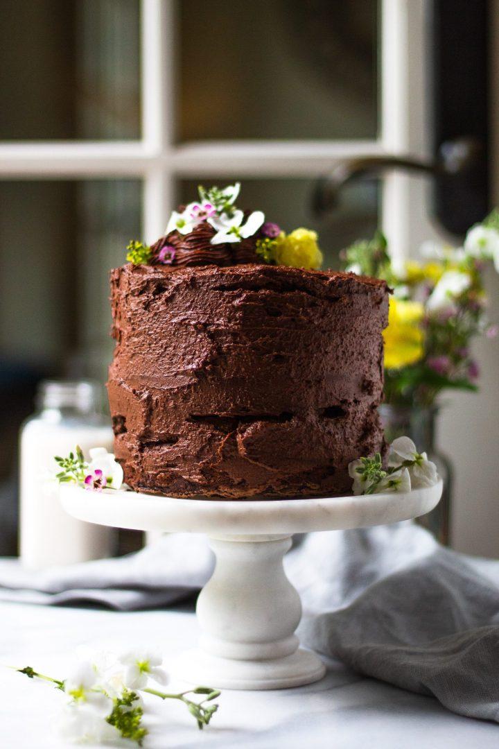 chocolate zucchini cake on cake stand