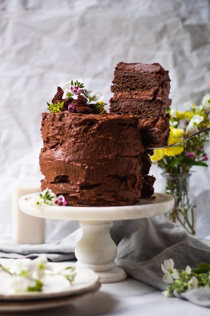 slice of chocolate zucchini cake taken from full cake