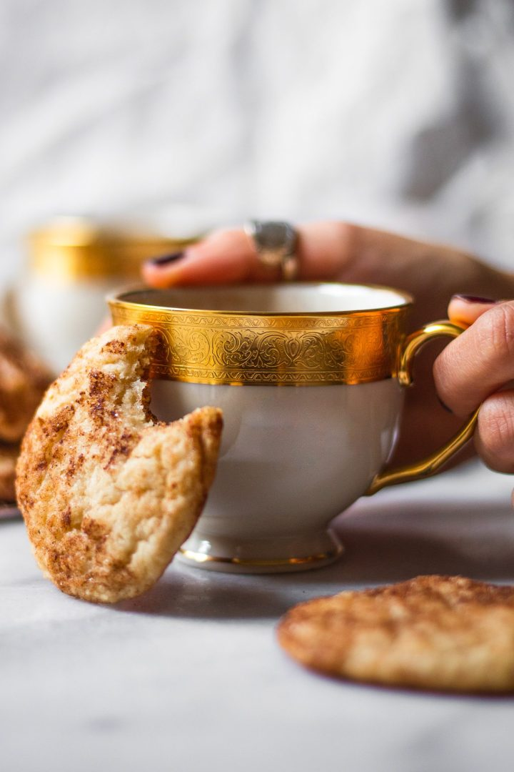 hand holding tea cup with snickerdoodle