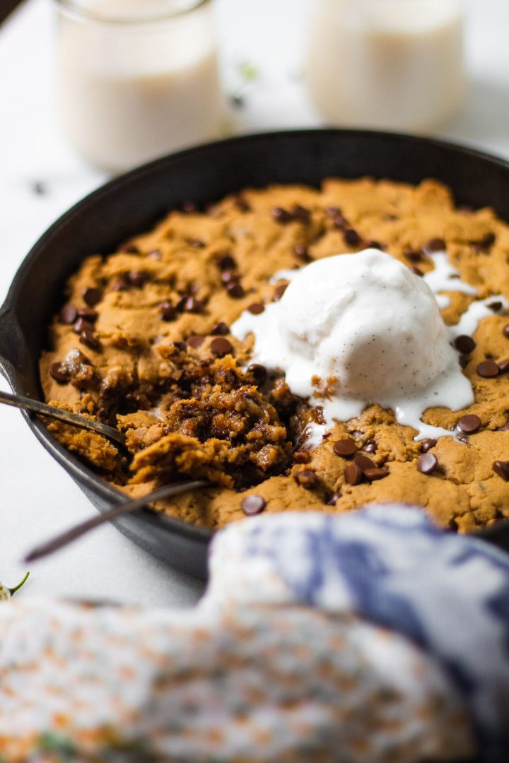 close up of spoons digging into cookie skillet