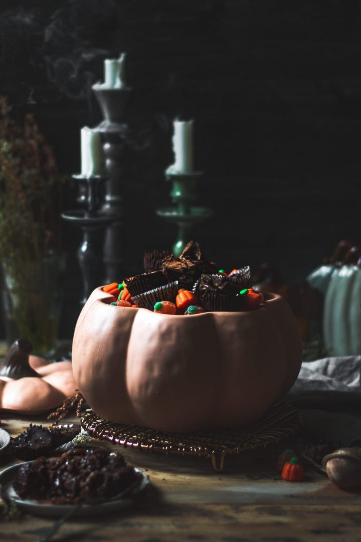 candles blown out over halloween food photography scene for lava cakes