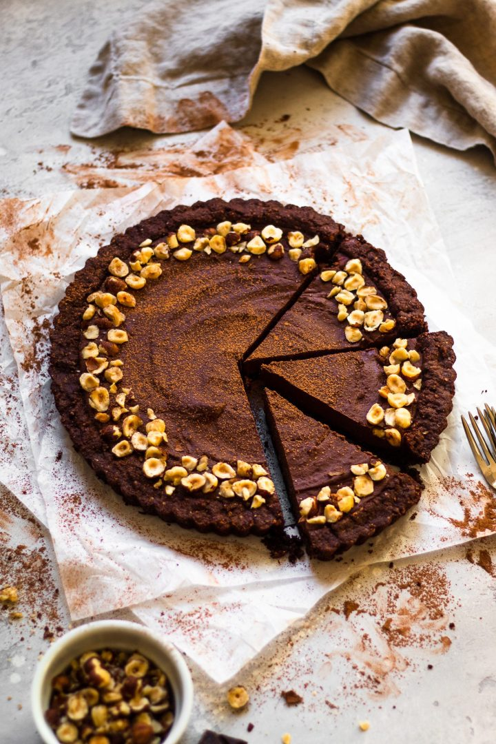 overhead of slices of chocolate hazelnut tart