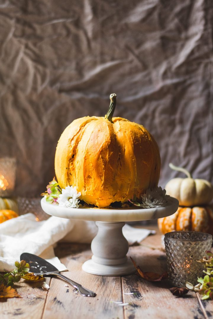 pumpkin cake on marble cake stand