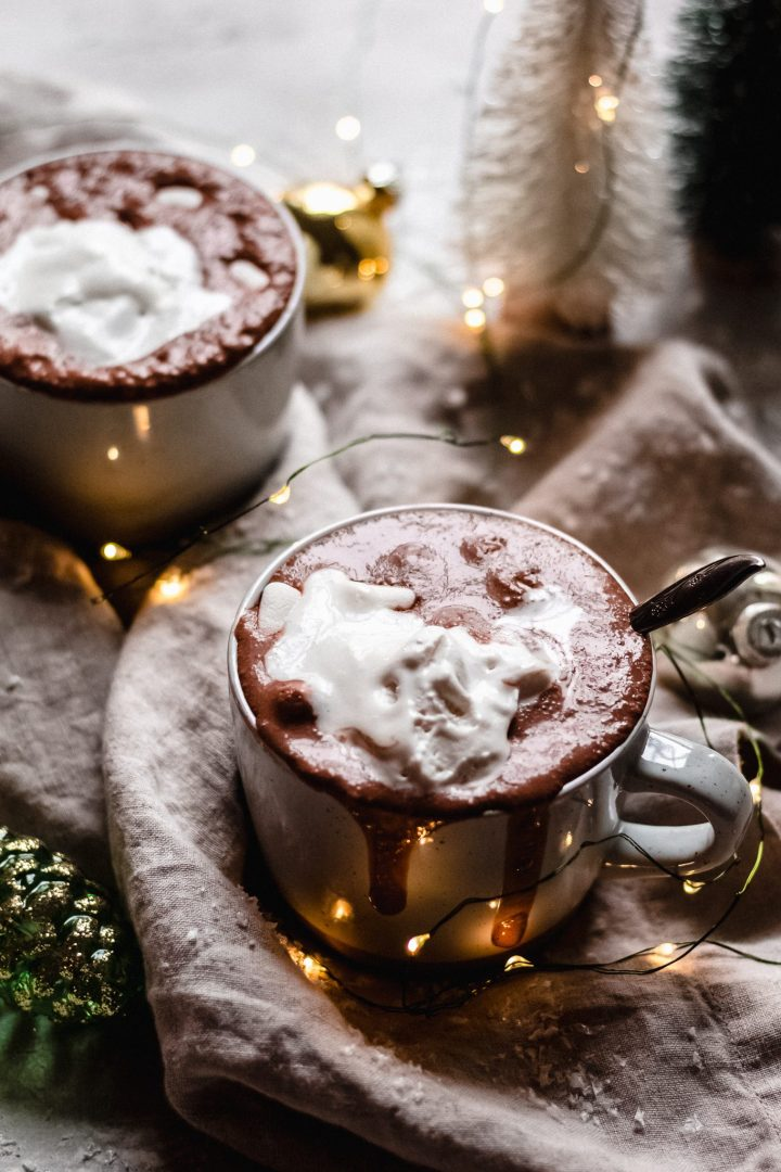hot chocolate overflowing from mug