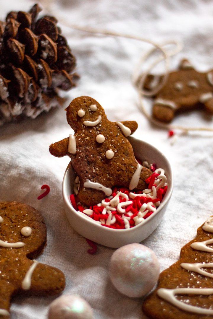 mini gingerbread man in bowl of sprinkles