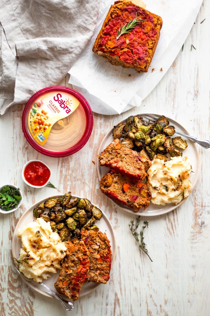 spread of plates with lentil loaf, mashed potatoes, and brussels sprouts