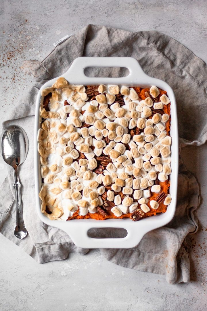 vegan sweet potato casserole with marshmallow and pecans