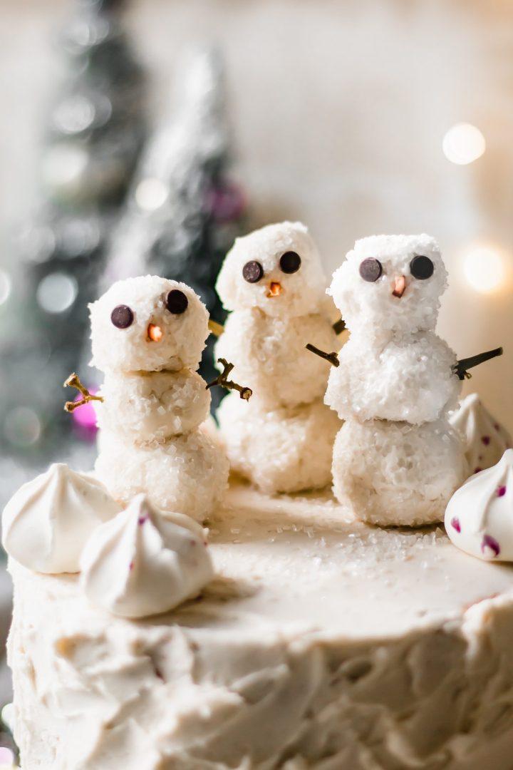 close up of buttercream frosting snowmen