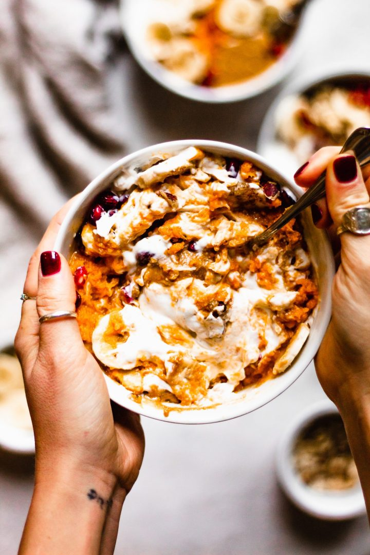 hand mixing together sweet potato bowl