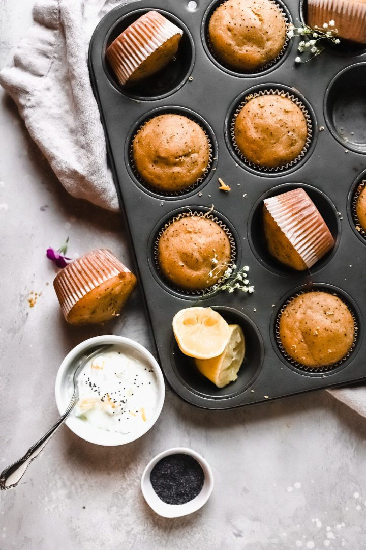 clos euh of muffin tin with lemon poppy seed muffins