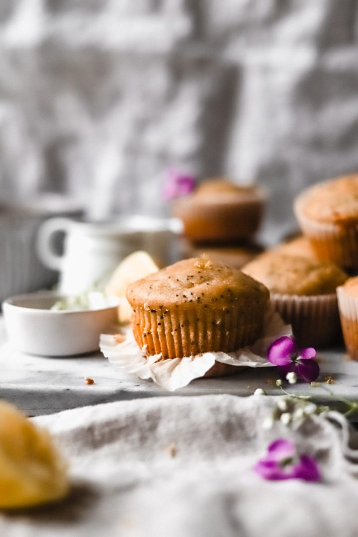 lemon poppy seed muffin with liner pulled down
