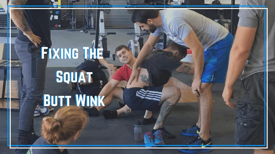 squat butt wink