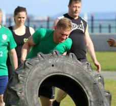 CrossFitter flipping a tire