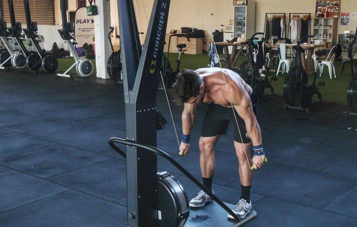 Khan Porter on the SkiErg doing a workout programmed by Sam Dancer. @iamkhanporter/Instagram