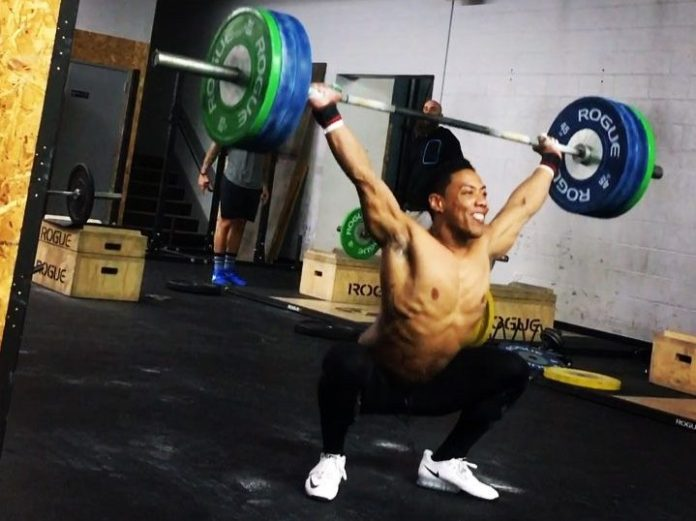OJ Washington snatching during CrossFit Open 17.3. @oj_washington/Instagram