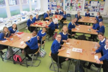 students at Waldegrave School in the U.K. make blocks for The 70273 Project