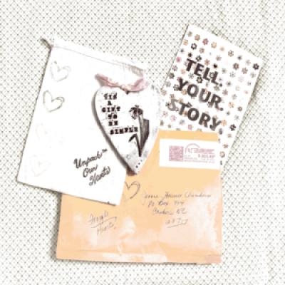 an envelope, a postcard, a drawstring bag, and a ceramic heart